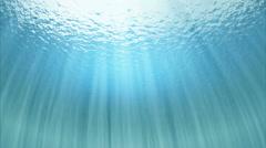 Ocean underwater below surface rays of light - stock footage