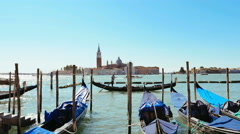 View of the lagoon from a pier where are moored gondolas Stock Footage