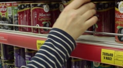 Girl takes a jar at the store - stock footage