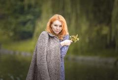 Young woman on nature. - stock photo