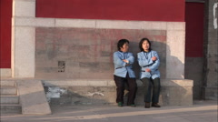 Chinese waitresses on a break, chatting Stock Footage