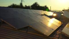 solar panels roof at sunset, photovoltaic green energy generator - stock footage