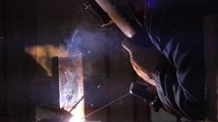 Shielded metal arc welding in metal workshop Stock Footage