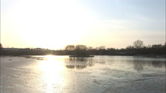 Sunlight on an icy lake in winter, Beijing Stock Footage