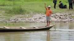 Boatman Crossing River in Nepal Stock Footage