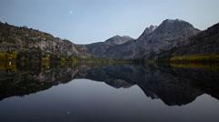 Time Lapse of Moonlit Alpine Lake Reflection Fall Foliage -Long Shot- - stock footage