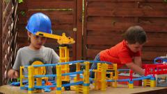 Boys building a road from a constructor Stock Footage