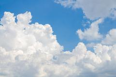 Stock Photo of Fluffy cloud with blue sky
