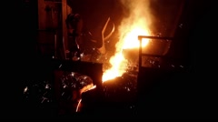 Foundry, molten metal poured from ladle for casting. - stock footage