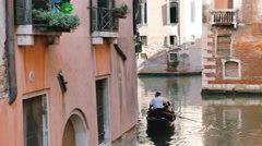 View of a gondola and a motorboat while sailing, venice - venezia Stock Footage