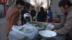 Street vegetable stall, Beijing alleyway Stock Footage