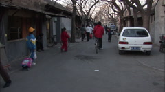 Busy Beijing alleyway, bicycle cart, China Stock Footage