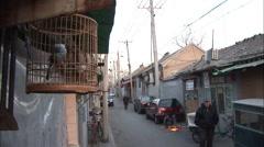 Stock Video Footage of Beijing alleyway, bird in cage, welding