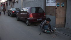 Stock Video Footage of Chinese man welding in alleyway, Beijing
