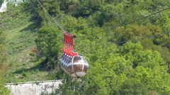 Slow moving cable cars in Grenoble France Stock Footage