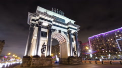 Triumphal arch in Moscow with Christmas illuminations at night timelapse Stock Footage