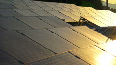 Solar panels roof at sunset, photovoltaic green energy generator Stock Footage