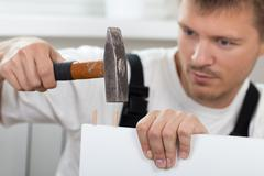 Man Assembling Furniture - stock photo
