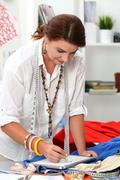 Portrait of adult female dressmaker Stock Photos