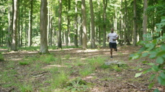 4K Muscular African American man going for a run in the woods - stock footage