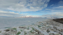 Arctic Landscape Pulling Back From Ice Covered Green And Blue Water Blue Sky Arkistovideo