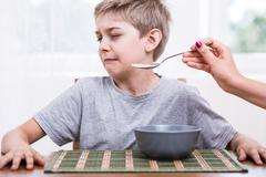 Refusing to eat disgusting food - stock photo