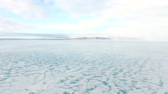 Arctic Landscape WS Over Snow Covered Blue And Green Water Grey Sky Arkistovideo