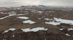 Arctic Landscape Land Brown With Snow Patches Mountain In Background Grey Sky Stock Footage