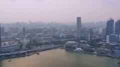 Pan of singapore skyline cityscape marina bay aerial view Stock Footage