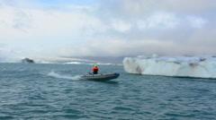 Iceland Jokulsarlon glaciers and icebergs on lake lagoon on edge of Vatnajokull Stock Footage