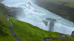 Iceland Gullfoss Falls on Hvita River from above with tourists walking on trail - stock footage
