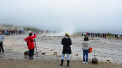 Reykjavik Iceland tourists waiting for erruption of the famous Stokkur geyser on Stock Footage