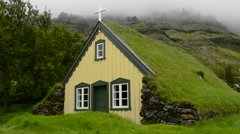 Iceland Hofskirkja yellow church turf grass in town of Hof in South Iceland 1884 Stock Footage