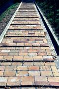Brick stairs downhill. hipster style. - stock photo