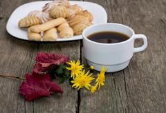 coffee, leaf, floret and plate with cookies behind, a still life - stock photo