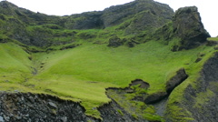 Iceland Reyniskirkja cliffs and rocks of the Black Beach in South Iceland Stock Footage