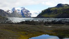 Iceland majestic glaciers with snow called Svinafellsjokull on right and Stock Footage