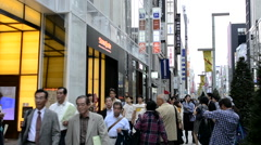 Tokyo Japan local crowds Ginza shopping area downtown with rush of locals and Stock Footage