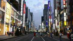 Tokyo Japan local crowds Ginza shopping twilight traffic blurs of movement on Stock Footage