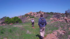 POV Family Hiking To Mountaintop- Wichita Mountains Nature Reserve Stock Footage