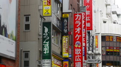 Tokyo Japan Brands all over street near Shibuya Station area of Shilbuya Stock Footage
