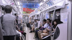 Tokyo Japan crowds subway car with locals going to work in crowded Stock Footage
