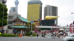 Stock Video Footage of Tokyo Japan  with golden horn of Kirin Beer with locals on street in Asakusa