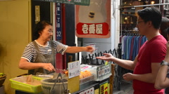 Tokyo Japan shopping center inside with locals woman vendo making rice cookies - stock footage