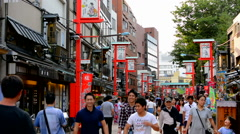 Tokyo Japan crowds walking at Sensoji Temple shops with old traditional shops at Stock Footage
