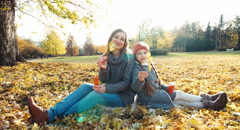 Happy family mother and daughter collects a bouquet of autumn leaves in the p Stock Footage