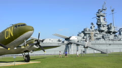 Mobile Alabama Battleship USS Alabama  from World War II with old plane at the Stock Footage