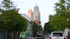 Stock Video Footage of Mobile Alabama downtown traffic on Dauphin Street with Trustmark Skyscraper.