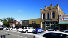 Rockwall Texas downtown Court House Square buildings and traffic Stock Footage