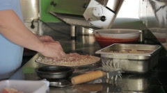 Chef preparing a pizza Stock Footage